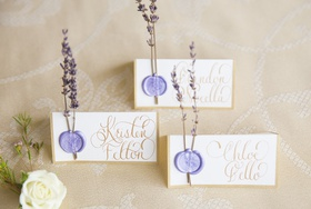 gold calligraphy place cards, lavender wax seasls, springs of lavender attached via wax seal