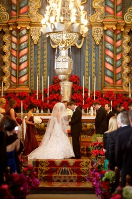 Bride and groom at colorful Catholic church wedding