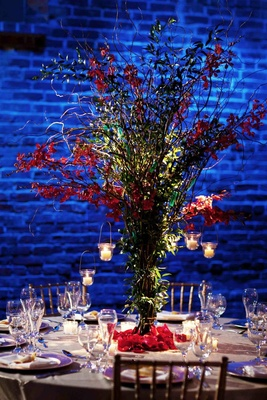Exposed brick wall with blue lighting and willow centerpiece