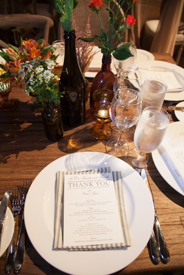 Striped dinner napkin topped with menu card