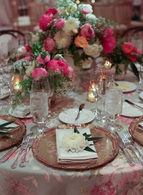 Wedding reception with printed flower linens and bright centerpieces
