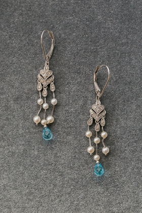 Diamond chandelier earrings with light blue stone