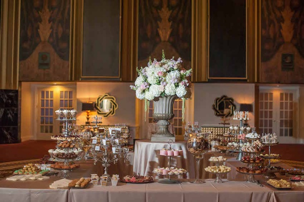 Wedding reception cookie table with cake pop, cupcake, chocolate mousse, macarons