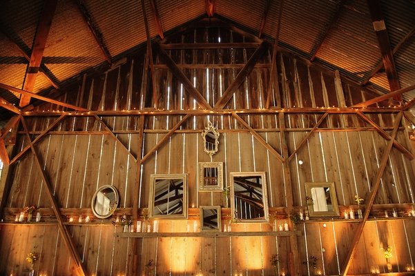 Barn wedding with mirror and candle decorations