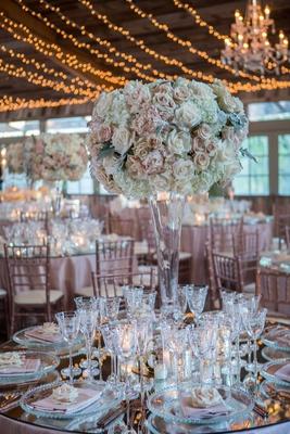tall wedding reception centerpiece pink white rose hydrangea dusty miller antique glassware silver