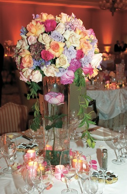 bouquet of different colors of roses on large glass vase