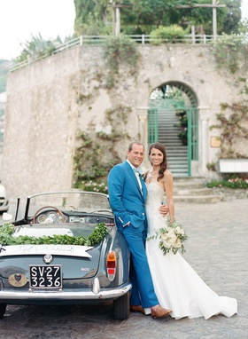 Wedding getaway car italy license plate garland just married banner sign groom in blue suit bride