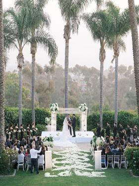 Wedding ceremony of Stephanie Ming NFL player Levine Toilolo football flower petal swirl aisle