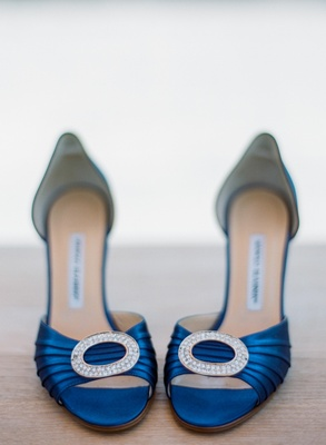 blue Manolo Blahnik shoes with jeweled brooch on front