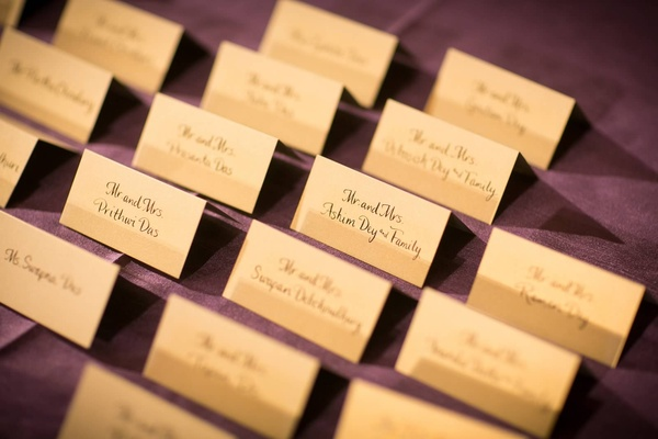 calligraphy place cards on plum linens