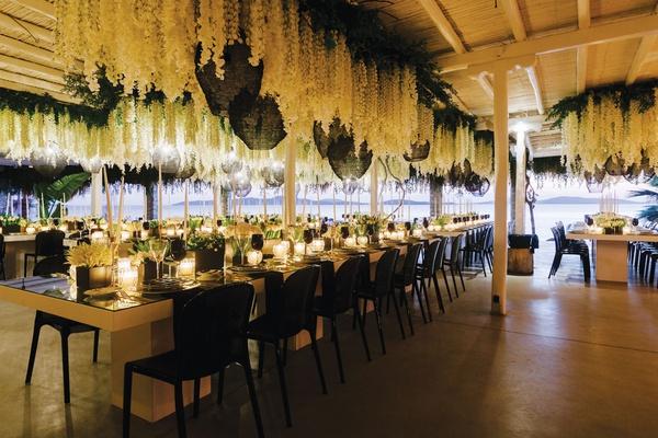 destination wedding decor view of aegean sea in mykonos greece flowers and woven pendants modern