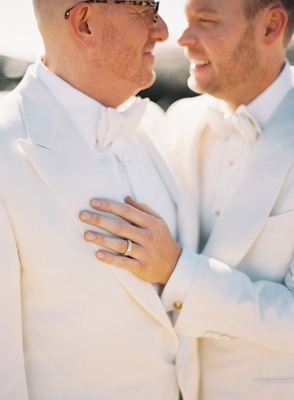 lgbtq gay same sex wedding couple matching white tuxedos bow ties gold cuff links bespoke tom ford