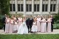 Bride in Ines Di Santo gown, bridesmaids in long pink dresses, groomsmen in tuxedos in courtyard