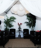 Beach wedding lounge area in white cabana tent