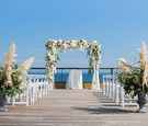 Montauk New York wedding ceremony desk pampas grass greenery white flowers white chairs