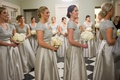 Bridesmaids in silver sequin bodices with full overskirts