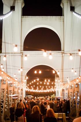 wedding reception at waco suspension bridge with lots of lights