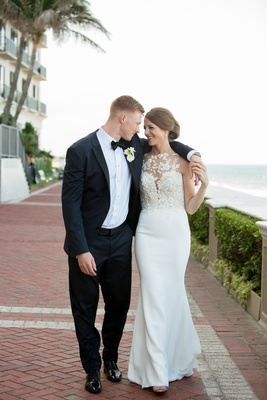 bride in pronovias atelier gown with floral appliques and crepe skirt, groom in midnight blue tuxedo