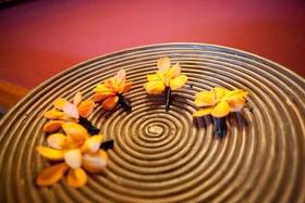 Orange mokara orchid boutonnieres