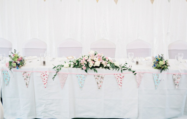 white head table diy details low floral arrangements handmade flags ivory blush flowers