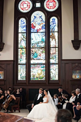 catholic church wedding with intricate stained glass windows