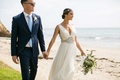 Bride in Jenny Packham sheath v neck wedding dress groom in sunglasses blue suit and tie