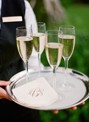 Silver platter topped with monogrammed napkins