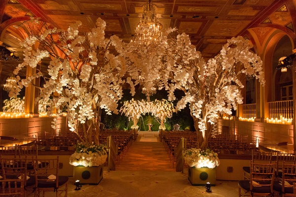 The Plaza Hotel white flowers trees in ballroom ceremony space with chuppah canopy orchids