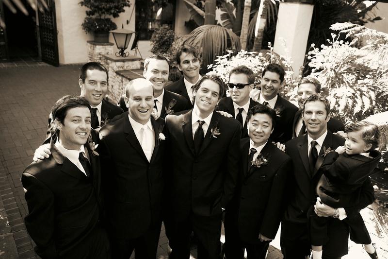 Black and white photo of groomsmen and ring bearer