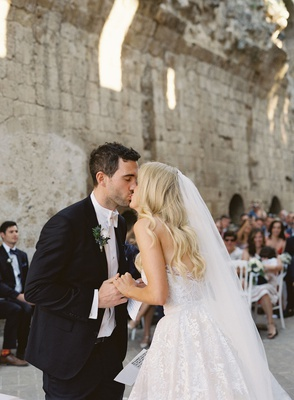 bride and groom kiss at symbolic wedding ceremony umbria italy old abbey 12th century venue