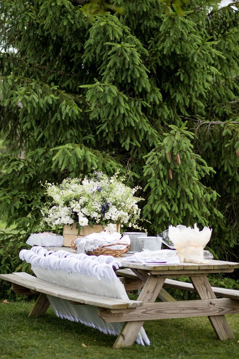 outdoor wedding ceremony wood picnic table with pashmina throws in baskets umbrella parasols more
