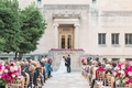 cincinnati art museum wedding with gold chiavari chairs and light and dark pink flower arrangements