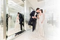 bride and groom in room with mirror walls veil strapless wedding dress champagne kiss