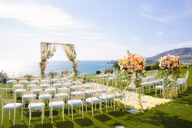 wedding ceremony yellow flower petal aisle arch ocean view ceremony chameleon chair collection chair