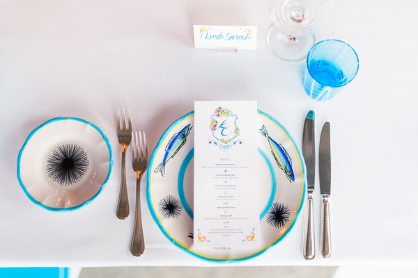 destination wedding in capri, italy, place setting with bright blue details, fish and sea urchin on