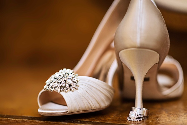 badgley mischka wedding shoes with bedazzled accent displayed with rings