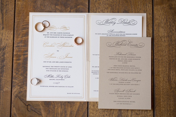 white invitation suite with gold script lettering, tan insert