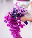 cascading orchid bouquet in shades of purple, violet, fuchsia