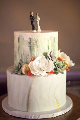 Wedding cake two layer white with brushstroke green paint inspiration sugar flowers succulents