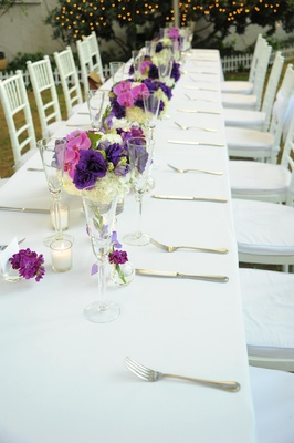 Outdoor white table with purple centepieces