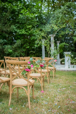 wedding ceremony chairs wood x back vineyard chairs decorated with greenery pink flowers