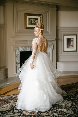 bride in hayley paige ruffled skirt ball gown, lace sleeves, illusion keyhole back