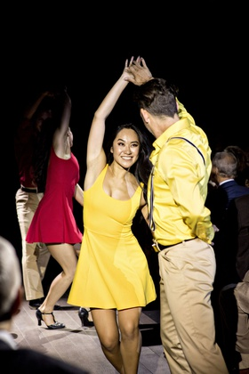 professional dancers in character shoes yellow red dresses yellow shirt suspenders khaki pants