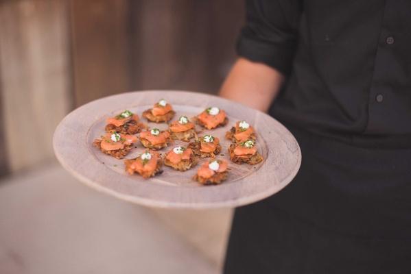 smoked salmon, potato scallion latke, dill creme fraiche, caviar on wood round tray cocktail hour