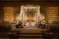 Jewish floral-embellished chuppah and candles