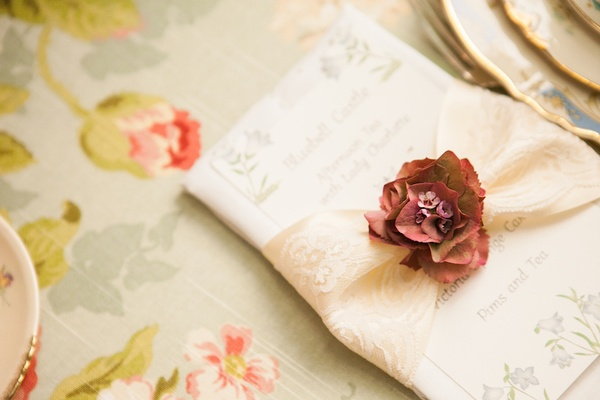 Antique hydrangea on lace napkin holder at afternoon tea
