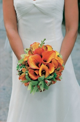 Orange calla lily wedding flower bouquet with orchid blossoms