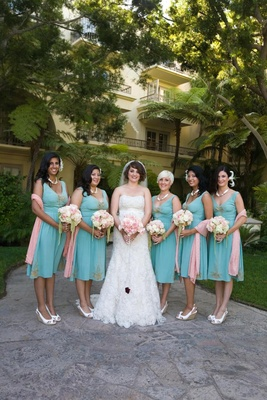 Bride with bridesmaids in short vintage turquoise dresses