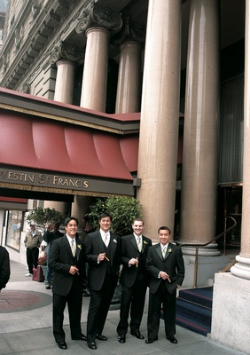 Groomsmen outside Westin St. Francis with cigars