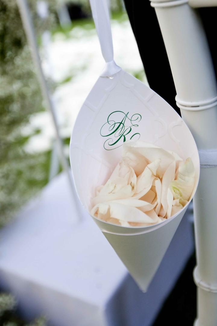 Green wedding monogram on paper cone filled with flower petals